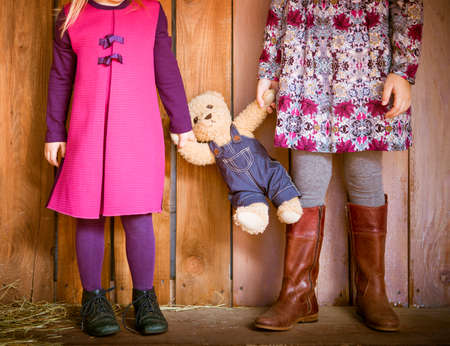 naptime: Two little sisters with toy bear. Close up Stock Photo