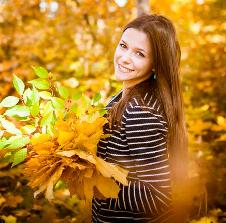 girl apple: Portrait of a beautiful teenage girl having fun in autumn park .Outdoor