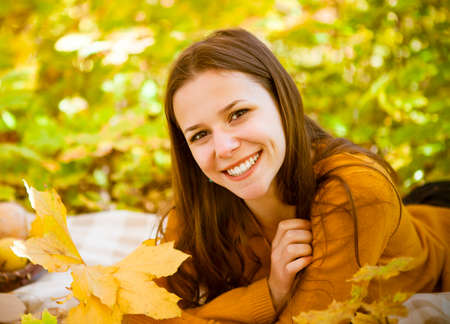 autumn young: Portrait of a beautiful teenage girl having fun in autumn park. Outdoor