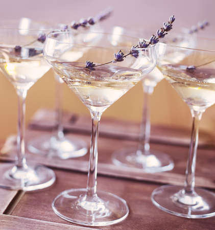 lavender: Glasses of champagne decorated with lavender on blurred background