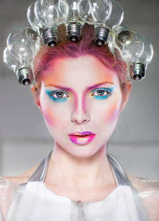 concept magical universe: Portrait of a futuristic young beautiful woman with creative make up