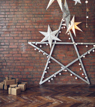 lofts: Christmas background with stars and presents over brick wall Stock Photo
