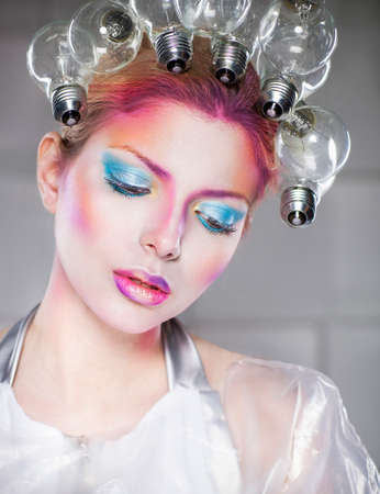 mystical: Portrait of a futuristic young beautiful woman with creative make up