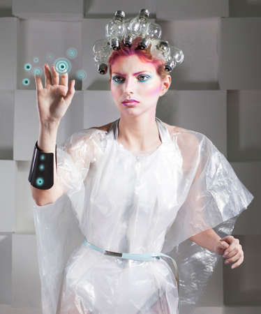 robot woman: Attractive blonde woman touching the button in virtual future interface