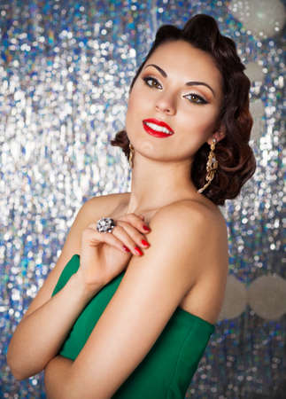 woman diet: Beautiful sexy young brunette woman with wavy hair, bright evening make up red lips over Christmas background