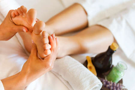 feet relaxing: Massage of human foot in spa salon. Close up