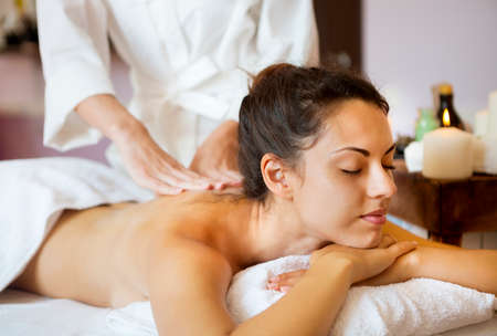 relaxation massage: Beautiful young woman relaxing with hand massage at beauty spa. Close up