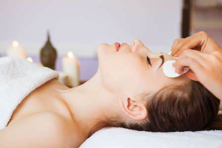 nourishing: Relaxed woman with a deep cleansing nourishing face mask applied to her face. Spa treatment Stock Photo