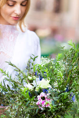 squaw: Beautiful wedding bouquet in the hands of the bride, bouquet of flowers in the style of boho