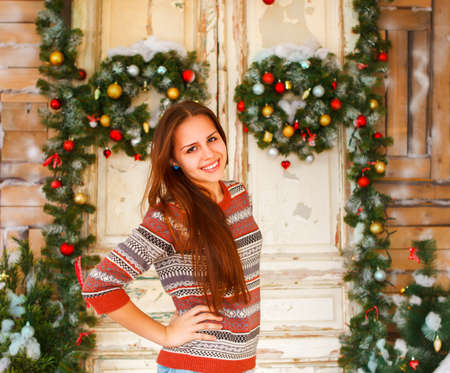 Portrait of the happy teen girl by the Christmas decorations photo