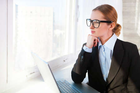 woman business suit: Young pretty business woman wearing eyeglasses with notebook in the office