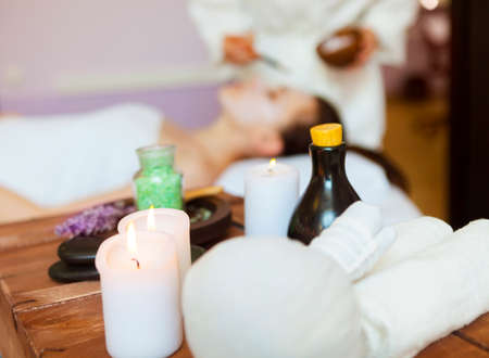 spa mud: Young beautiful woman in a mask for the face of the therapeutic white mud. Spa treatment