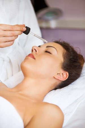 beauty center: Close up portrait of a young woman getting spa treatment. Face massage Stock Photo