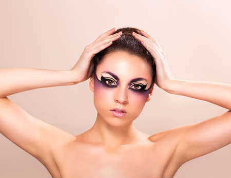 fantasy makeup: Fashion photography of beautiful young woman with fantasy makeup Stock Photo