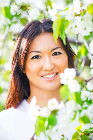 bloomy: Happy smiling young girl in bloomy spring  garden Stock Photo