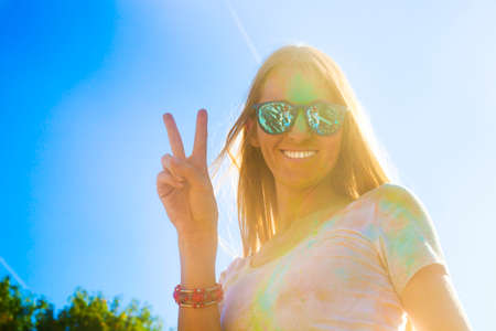 worshipers: Portrait of happy young woman on holi color festival Stock Photo