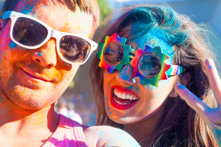 color: Portrait of happy couple in love on holi color festival Stock Photo