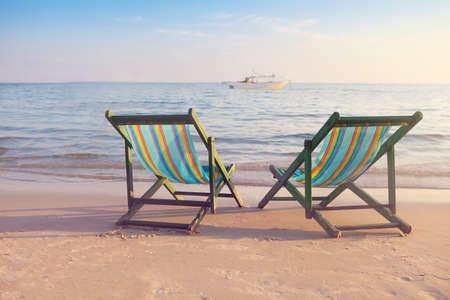 koh samet: Two empty sun chairs on the beach of Koh Samet, Thailand