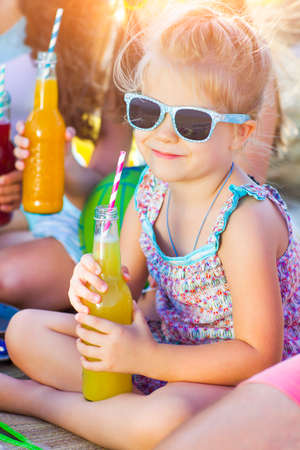 Little smiling girl with lemonade Stock Photo