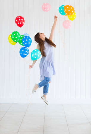 helium: Happy young teen girl with helium air balloons. Holidays and happiness concept Stock Photo