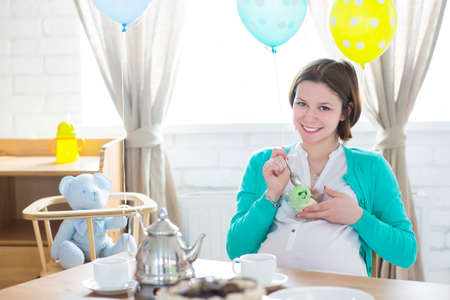 parents with baby: Happy pregnant woman with ice cream smiling Stock Photo