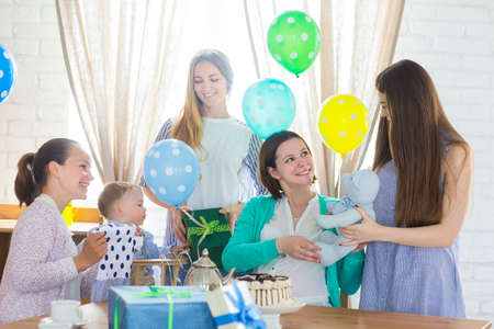 baby boomer: Portrait of pregnant woman with friends at a baby shower Stock Photo