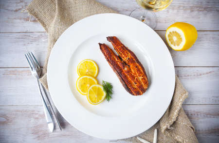 salmon steak: Salmon steak grilled with lemon and white wine. Top view