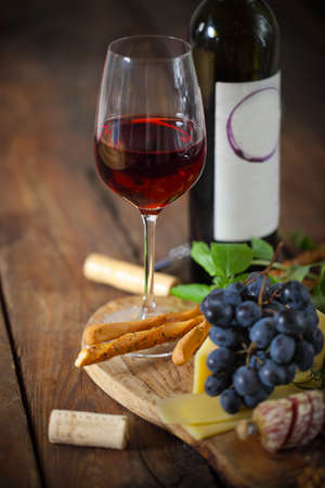 food and wine: Italian food ingredients with red wine on wooden background