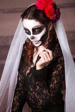 Beautiful woman painted as skeleton. Halloween theme Stock Photo