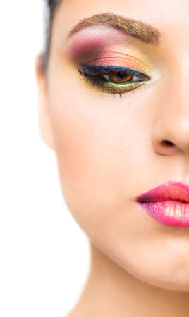 make up model: Close up portrait of a beautiful young brunette model with bright make up. Close up of abstract multicolor make up. Makeup Pigment powder explosion
