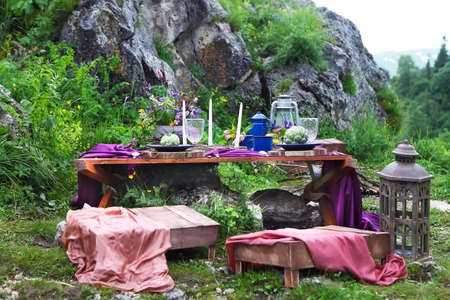 table setting: Wedding table setting decorated in rustic style. Mountains view