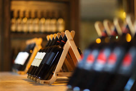 Wine bottles on a wooden shelf. Wine bar.