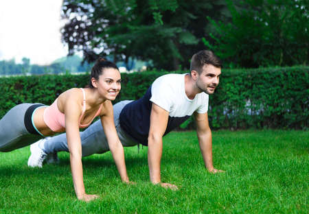 Young happpy couple exercising and stretching muscles before sport activity  Stock Photo