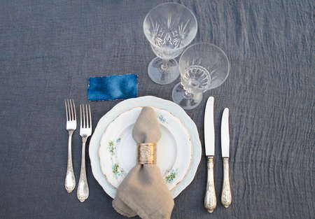 Table set for dinner with glasses, close up
