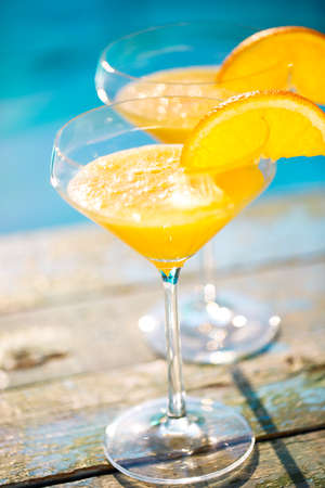 Champagne glasses with orange slice. Mimosa cocktail. Summer pool party