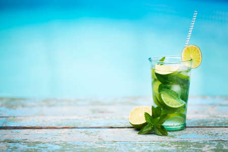 lifestile: Cocktail glasses at pool, beach side. Mojito Stock Photo