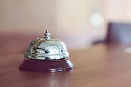 Close up of a hotel bell in retro style on reception desk