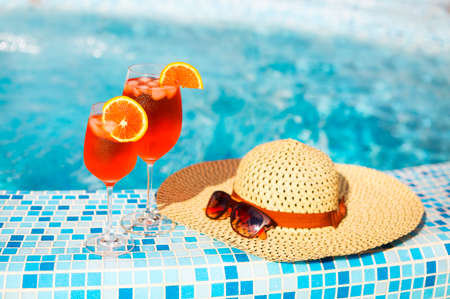 spritz: Glasses of orange alcohol cocktail with orange slice on turquiose water background with orange slice Stock Photo