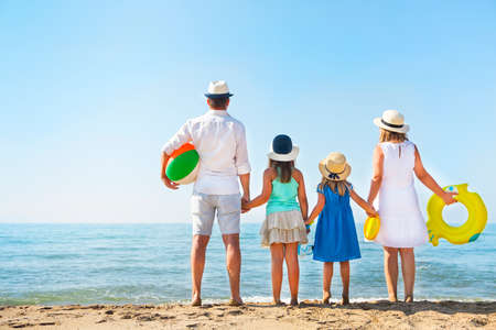 Young family with two children at beach. Holiday and travel concept photo