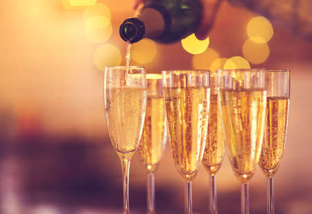Champagne glasses on gold background. Party and holiday celebration concept
