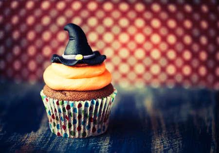 Halloween design homemade cupcake on dark background