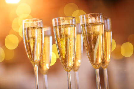 Champagne glasses on golden background. Party and celebration concept