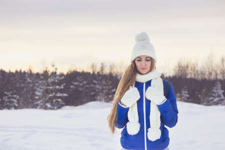 Cute young woman in wintertime outdoor, Karelia, Russia Stock Photo