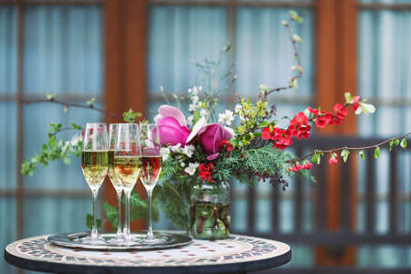 Champagne glasses on silver tray outdoors  Stock Photo