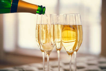 Champagne glasses and champagne bottle. Party and holiday celebration concept