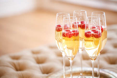 Champagne glasses on silver tray. Party and holiday celebration concept