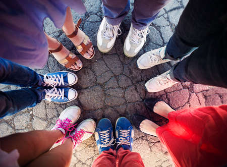 Group of friends with their legs in a complete circle. Friendship concept Stock Photo