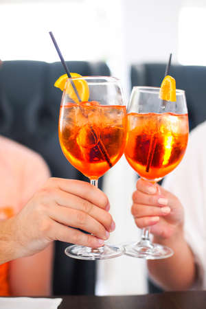Two cocktail glasses in the man and woman hands.