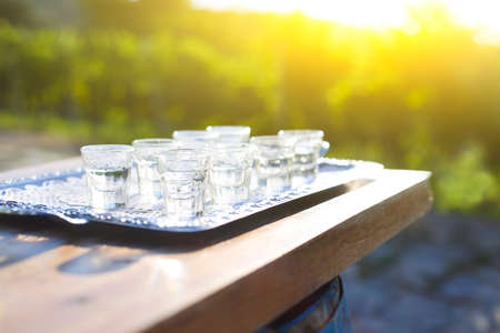 Grapes spirits glasses on metal tray outdoors