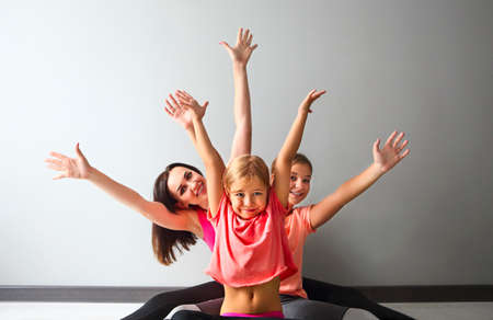 Young woman having fun with kids after yoga